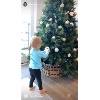 Stars Decorate Christmas Trees Jade Roper and Tanner Tolbert