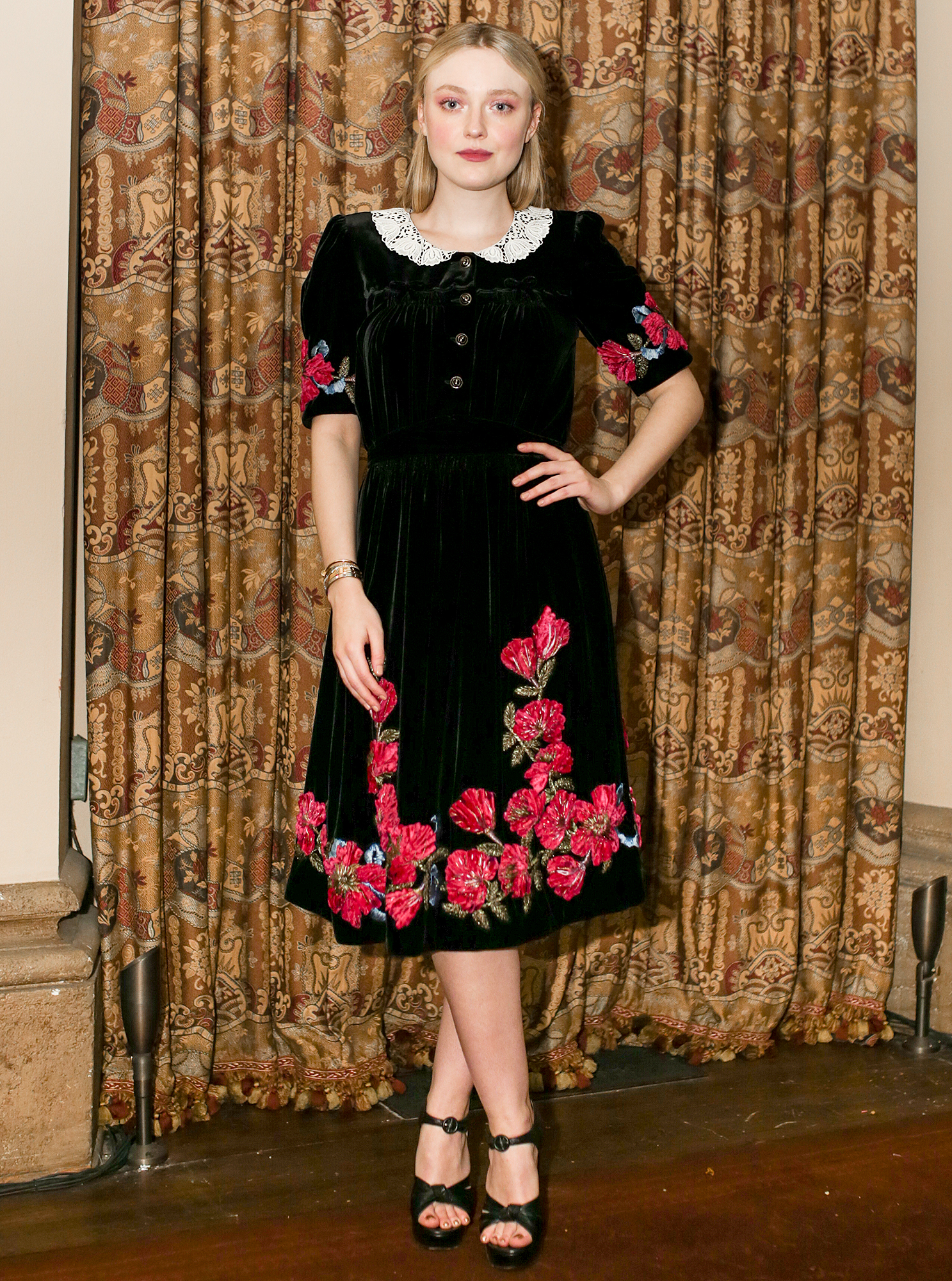 Dakota Fanning Stunned in a Floral Print Dress While Hosting the 'Eat the Sun' Book Launch Party With Gucci