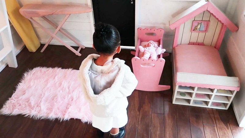 https://www.usmagazine.com/wp content/uploads/2019/12/Doll and Bed Inside Kylie Jenners 22 Month Old Daughter Stormis Epic Playhouse From Kris
