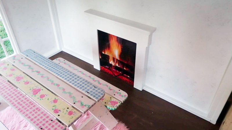 https://www.usmagazine.com/wp content/uploads/2019/12/Fireplace Inside Kylie Jenners 22 Month Old Daughter Stormis Epic Playhouse From Kris