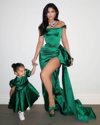 Kylie Jenner and Stormi in Matching Green Dresses on Christmas Day
