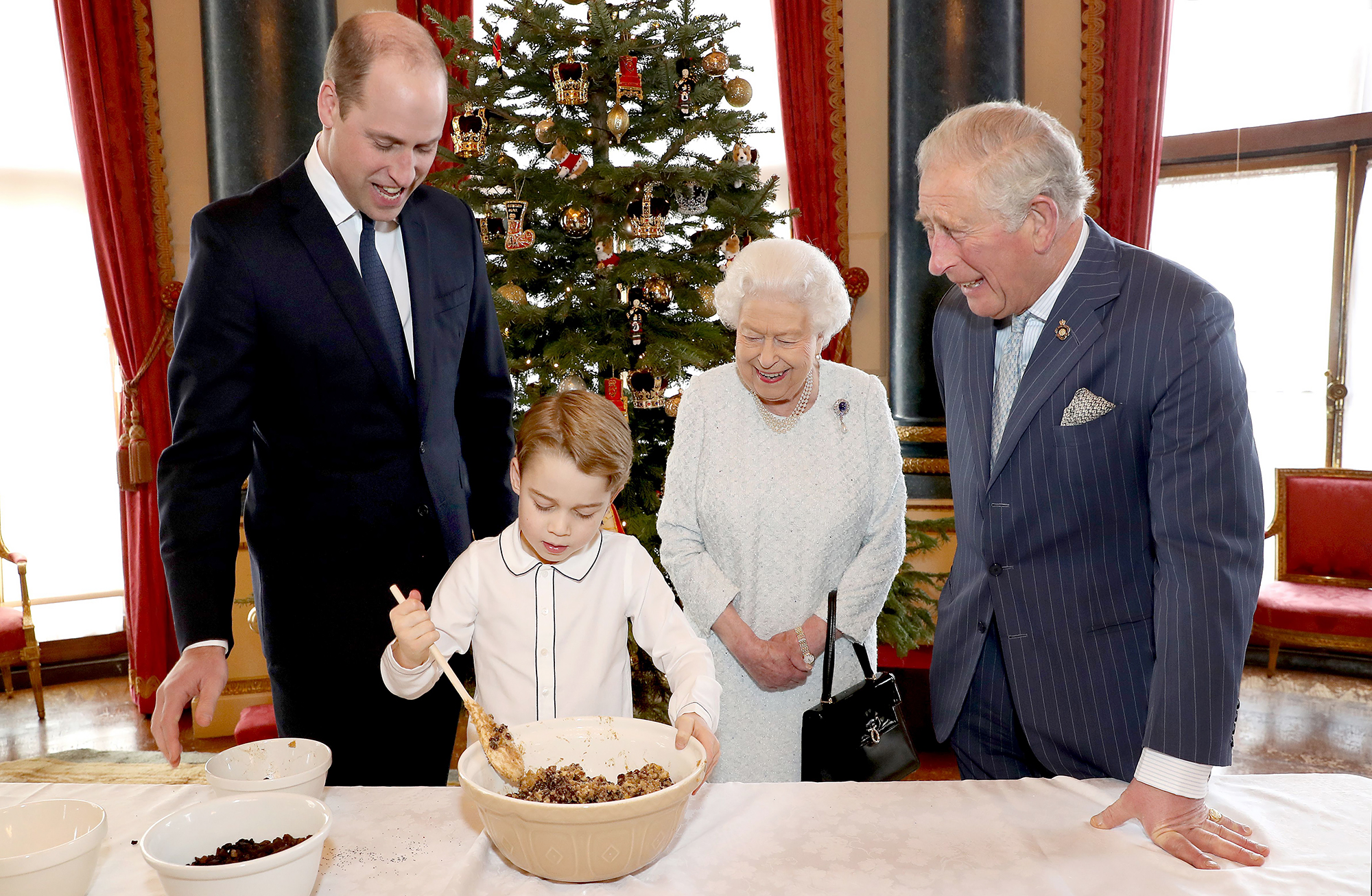 Prince George Adorably Struggles to Mix Christmas Pudding in New Video and the Queen Laughs