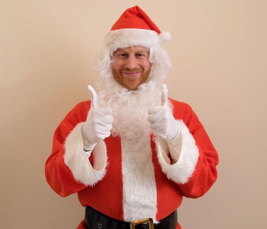 Prince Harry Dressed As Santa Thumbs Up