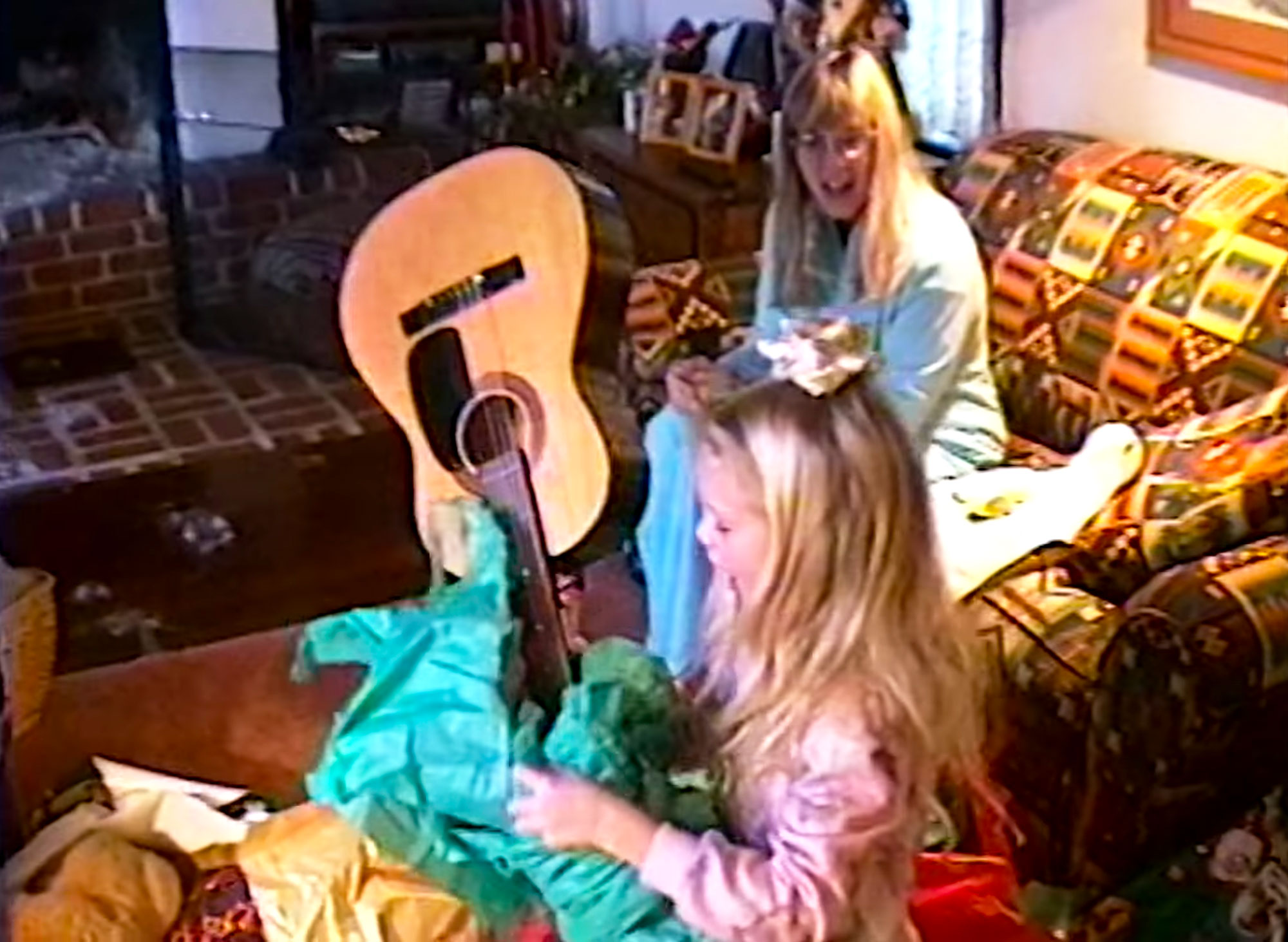Taylor Swift Receives a Guitar as a Gift in Video for Christmas Tree Farm