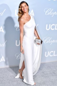 Gisele Bundchens Secrets to Staying in Shape Gisele Bundchen attends the Hollywood for Science Gala in a Tight White Dress