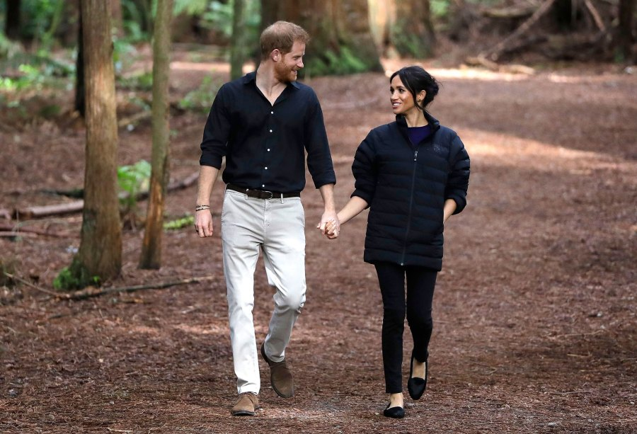 Prince Harry and Meghan Duchess of Sussex Walk Through a Redwoods Forest
