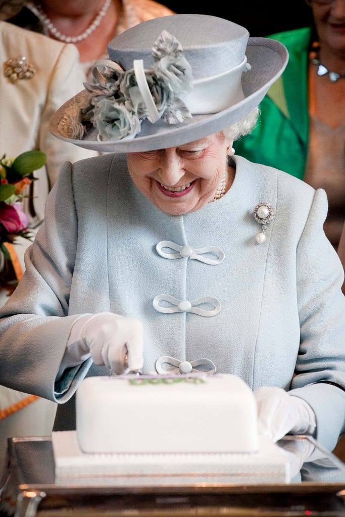 Queen Elizabeth II Cutting Cake