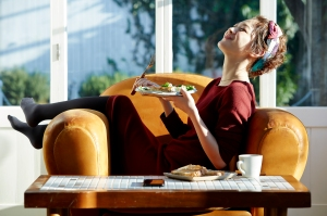 Woman enjoying a meal on her couch