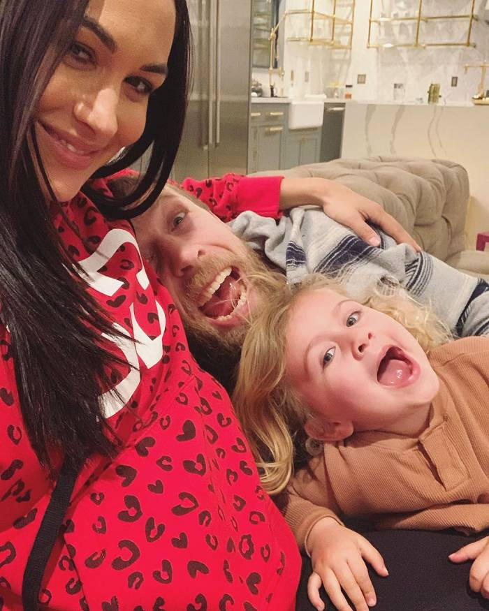 Brie Bella Baby Bump with Husband and Daughter