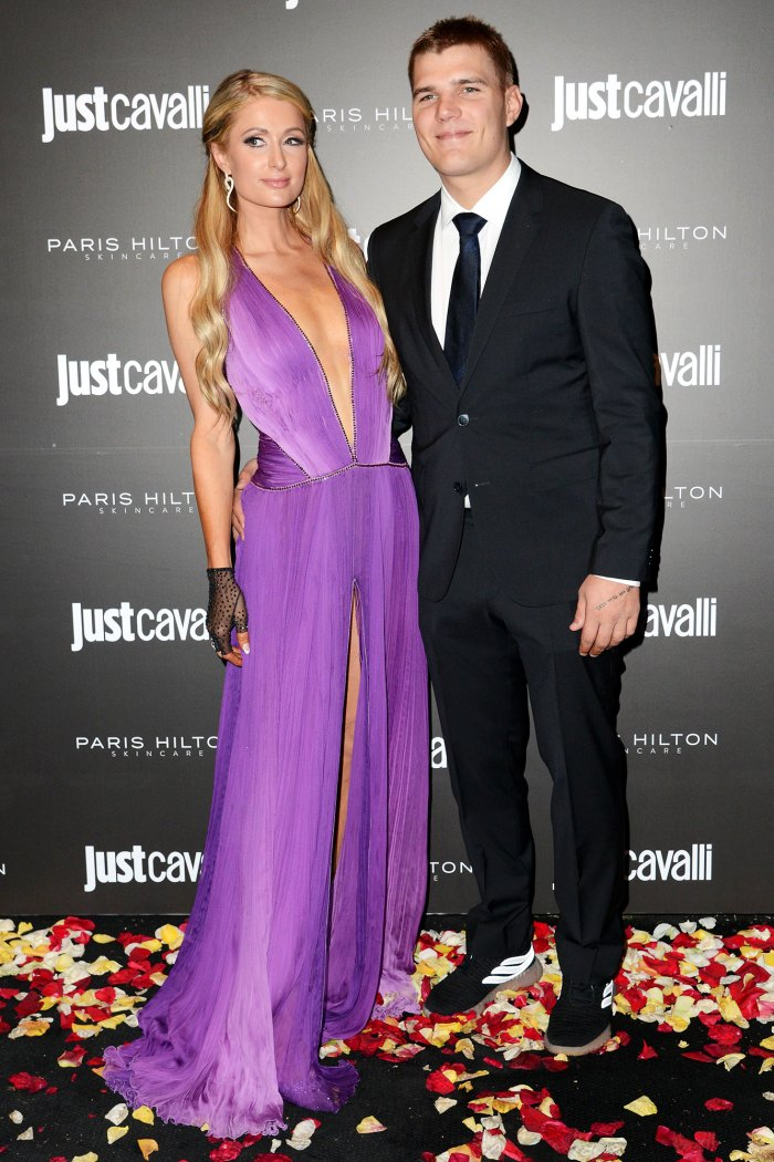 Paris Hilton and Chris Zylka Just Cavalli Paris Hilton Skincare Event Purple Dress