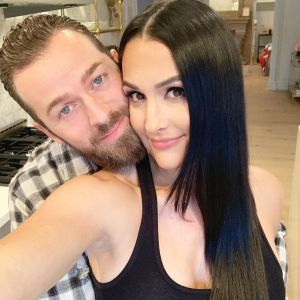 Pregnant Nikki Bella Flips the Switch in Her Old Wrestling Outfit in Tik Tok With Artem Chigvintsev
