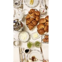 What Kim and Kourtney Kardashian Are Eating in Paris During Fashion Week Breakfast Spread Croissants