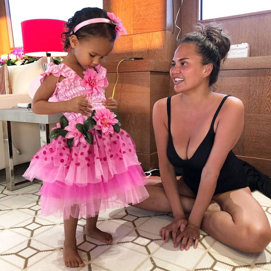Chrissy Teigen Catches Daughter Luna Snacking in the Pantry Batching Suit Pink Dress