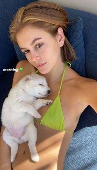 Kaia Gerber Relaxes in a Neon Bikini With Adorable Puppy