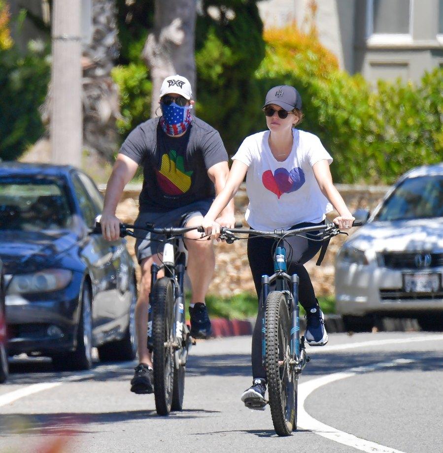 Pregnant Katherine Schwarzenegger Reveals Her Baby Bump on Bike Ride With Chris Pratt