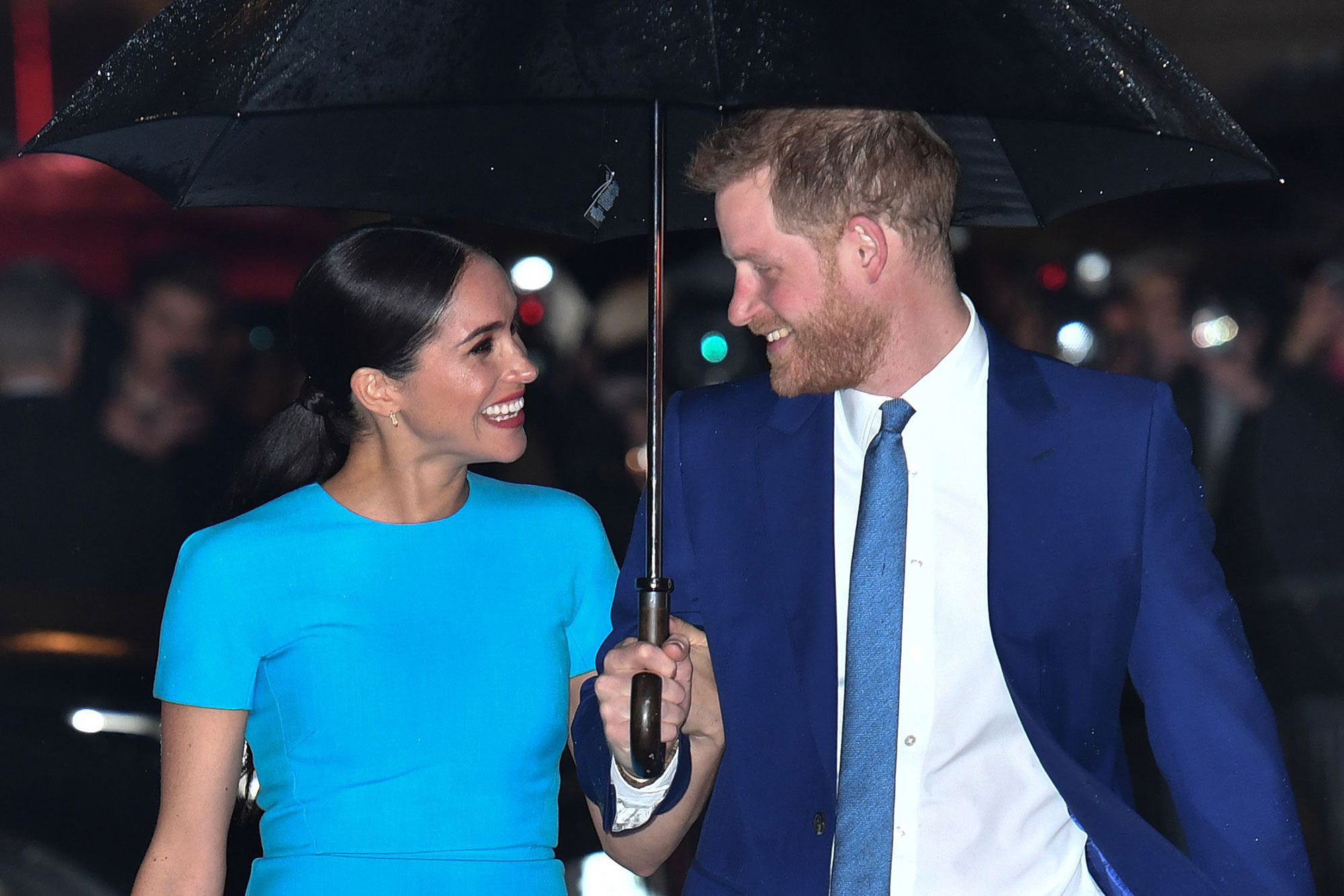 prince harry meghan were really happy with iconic rain photo prince harry meghan were really happy