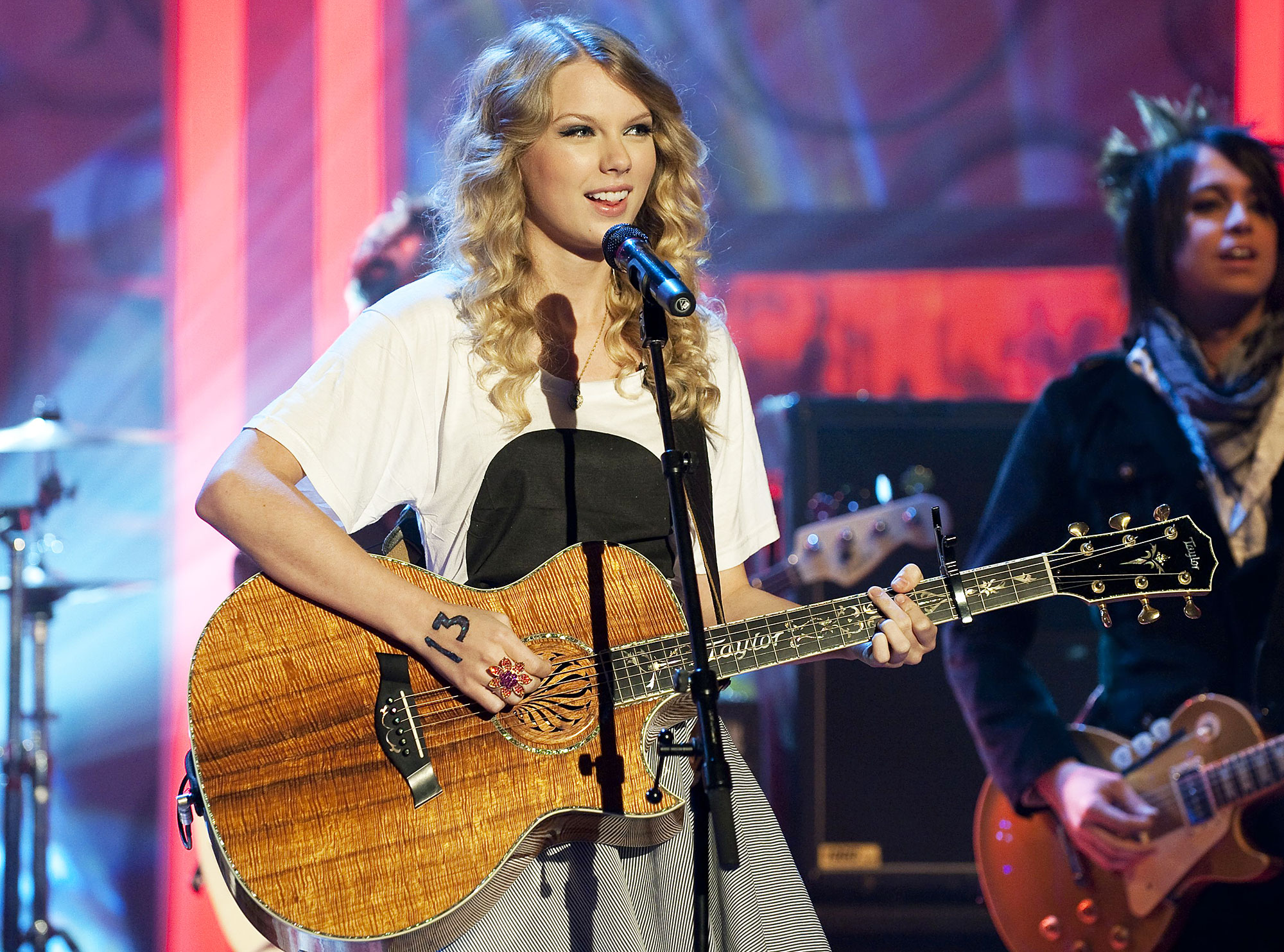 Taylor Swift performing in 2009 Taylor Swift Claims Her Former Label Is Putting Out an Album Featuring Her Live Songs