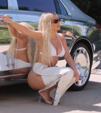 Kim Kardashian Pairs White Lingerie With Assless Leather Chaps