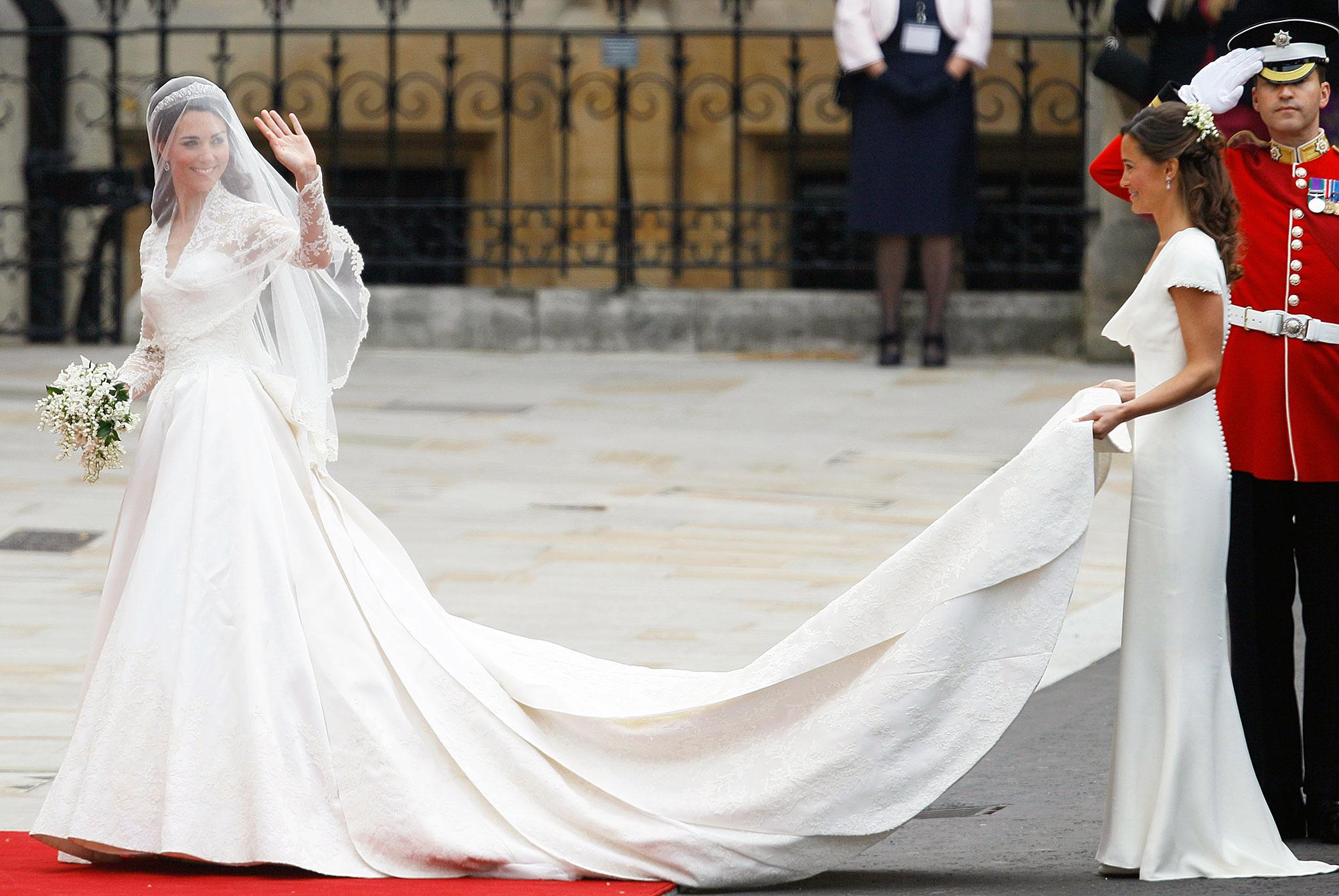 Pippa Middleton Holding Kate Middleton Wedding Train and Kate Waving to Crowd