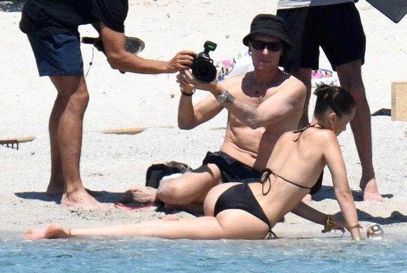 Bella Hadid Stuns On-Set in Corsica in a Black Bikini: Pics