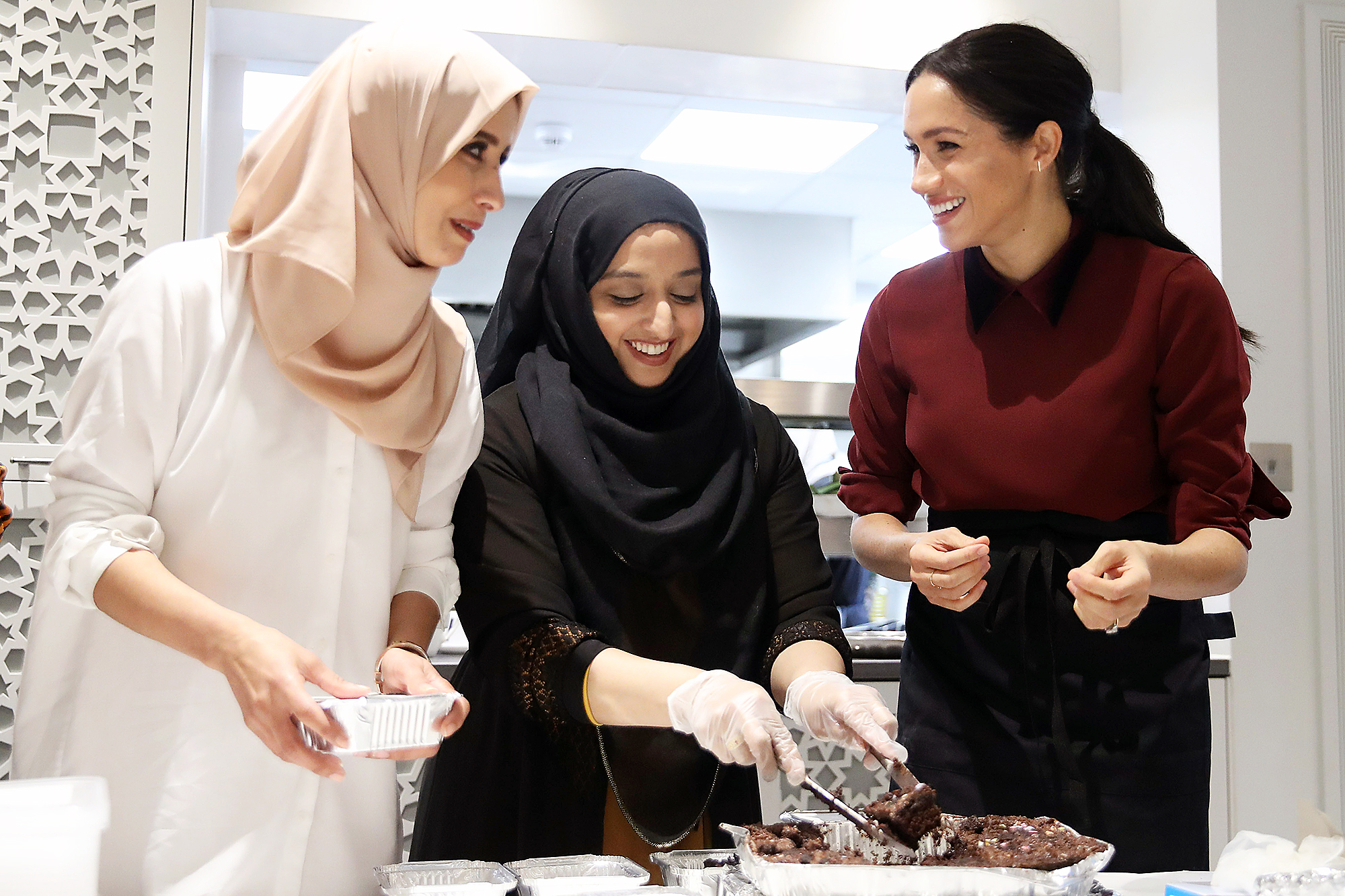 Meghan Markle visits the Hubb Community Kitchen Prince Harry and Meghan Markle Send Thanks to UK Charity for Distributing Meals During the COVID-19 Pandemic