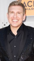 Todd Chrisley Slams Troll Who Criticized the Color of Granddaughter Chloes Skin p