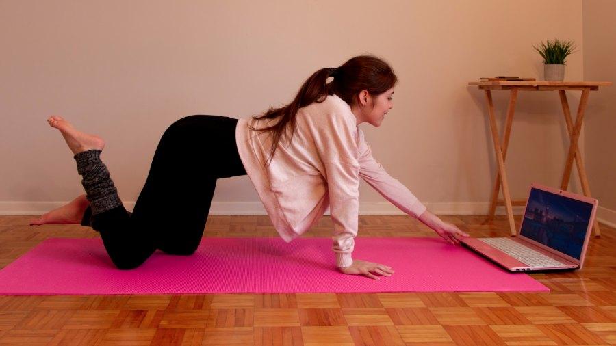 woman-doing-yoga-at-home