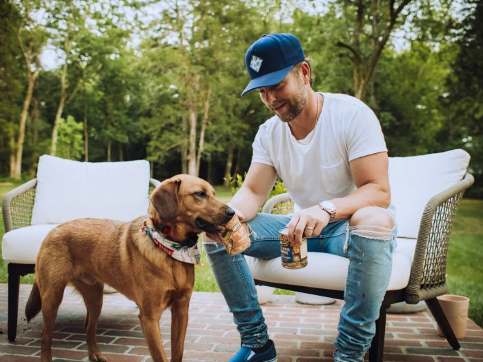 Chris Lane with Cooper for New Merrick BBQ