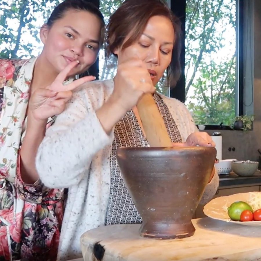 Chrissy Teigen cooking with mom
