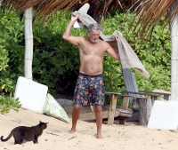 Pierce Brosnan drying off beach Hawaii