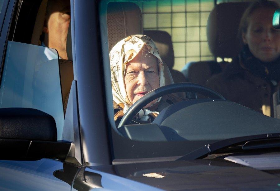 Queen Elizabeth II driving a car