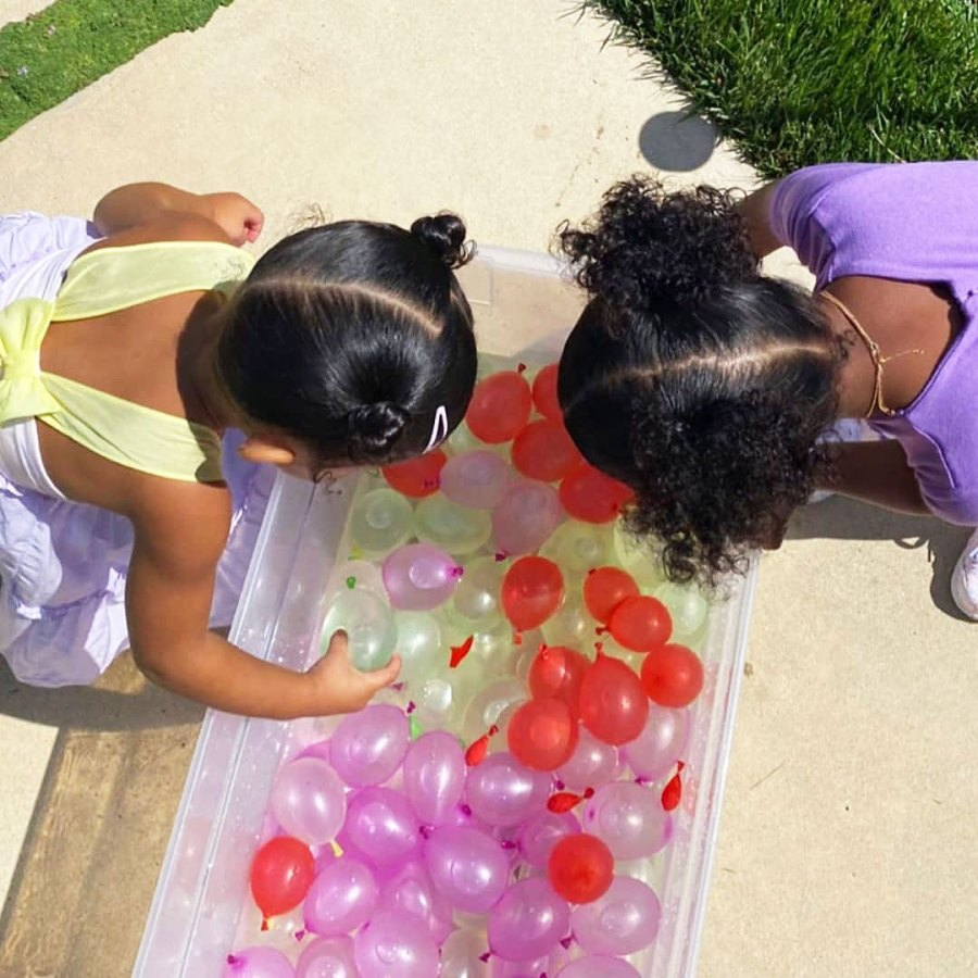Stormi Webster and True Thompson Playing with Water Balloons