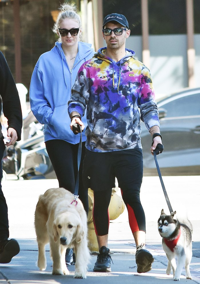 Sophie Turner and Joe Jonas walking their dogs Joe Jonas Pays Tribute to His Squad on National Dog Day