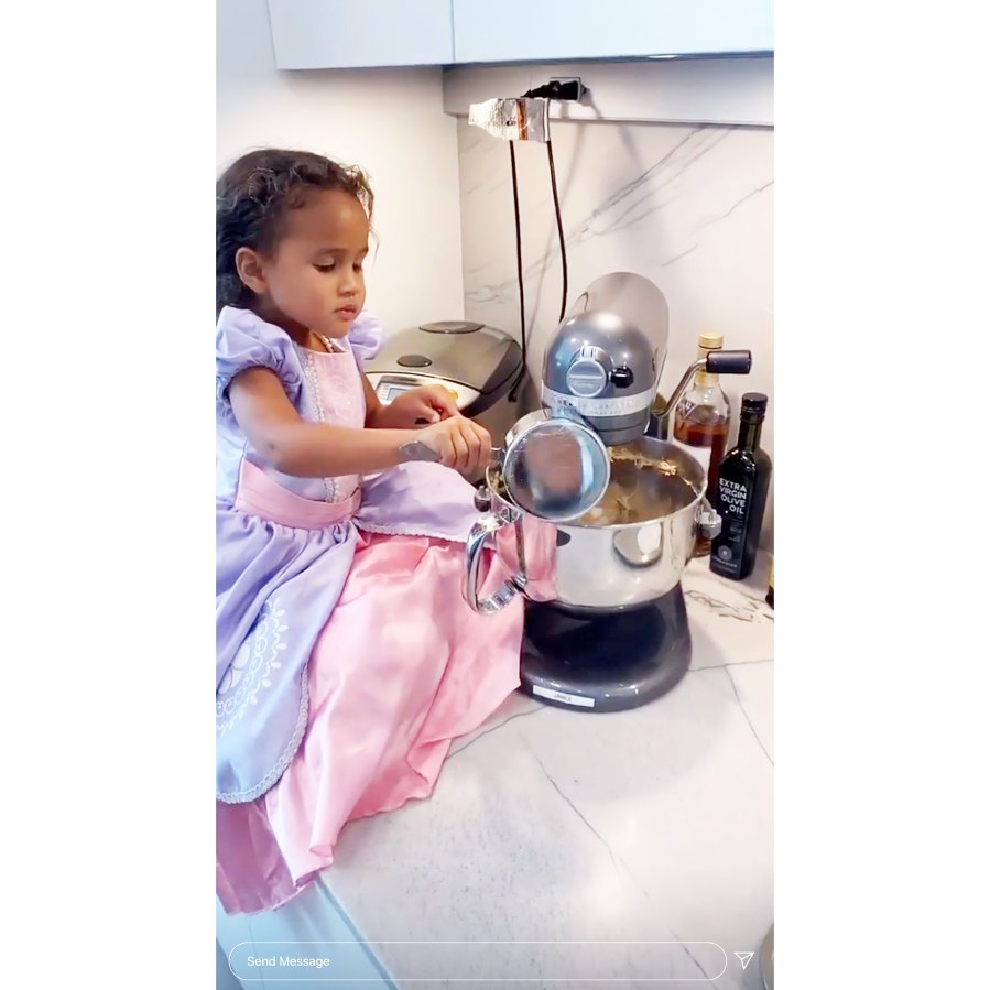 Chrissy Teigen Daughter Luna Uses mixer in a princess gown and a pearl necklace