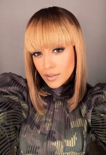 Tia Mowry Shows Off Her 'Fun' New Blonde Wig