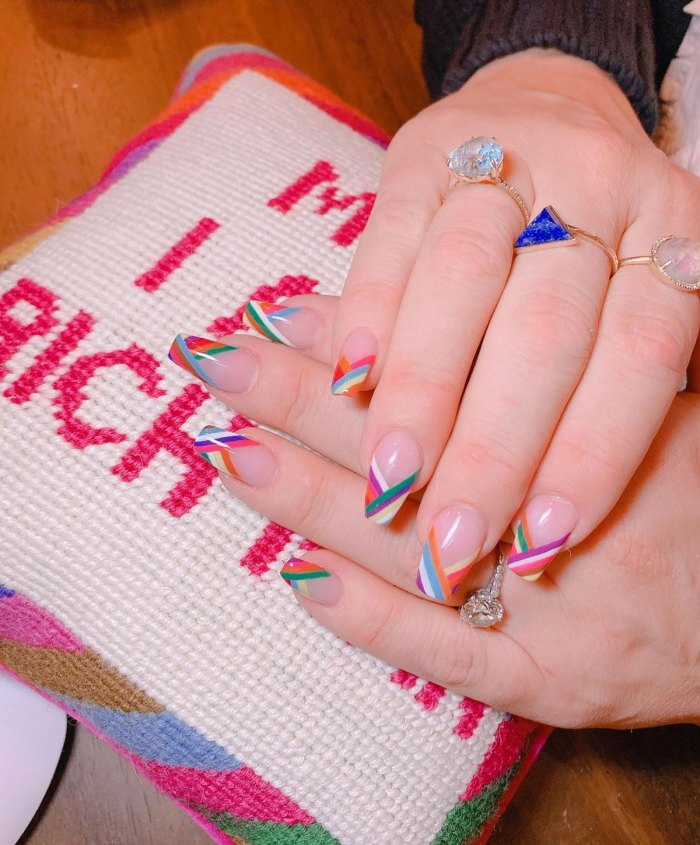 Busy Philipps pairs her mani with the most epic cross stitch pillow