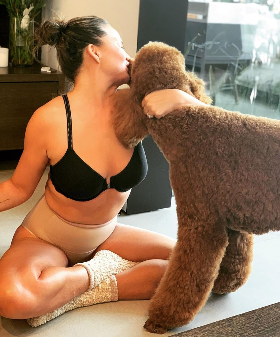 Chrissy Teigen in a Bra, Spanx and Fuzzy Socks Is Our Winter Aesthetic