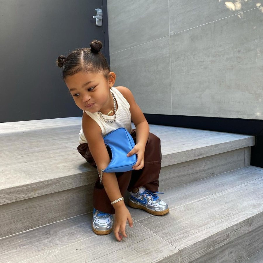 Kylie Jenner Stormi Space Buns Blue Purse Turning 3