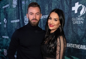 Nikki Bella and Artem Chigvintsev Celebrate 1st Christmas With Son Matteo in Holiday Card
