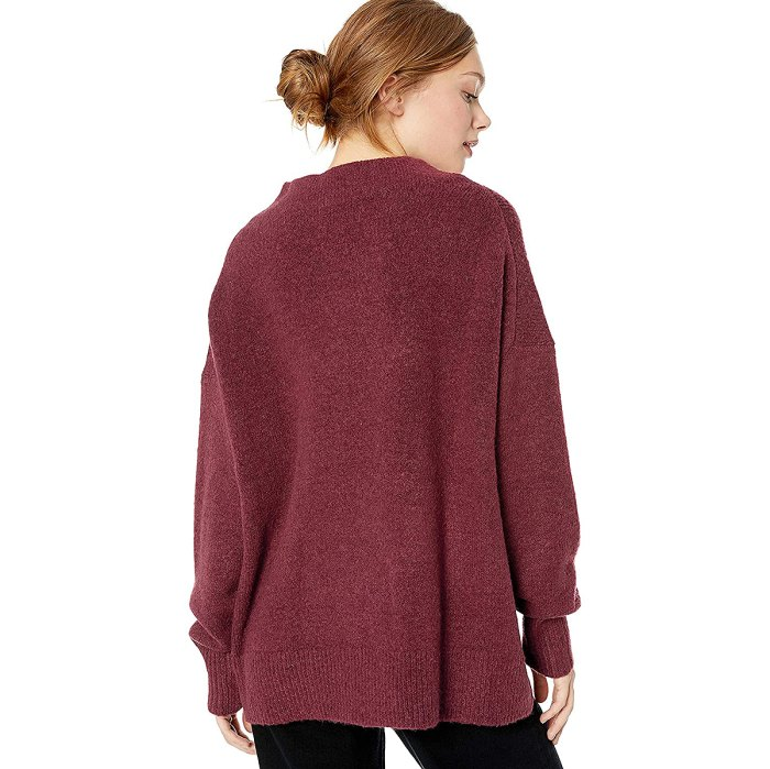 Suéter acogedor con cuello alto y punto de ochos