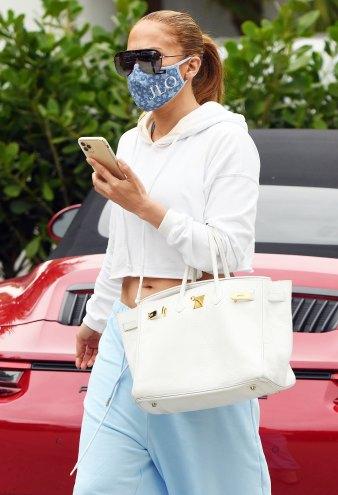 Jennifer Lopez Wearing A Personalized JLo Face Mask