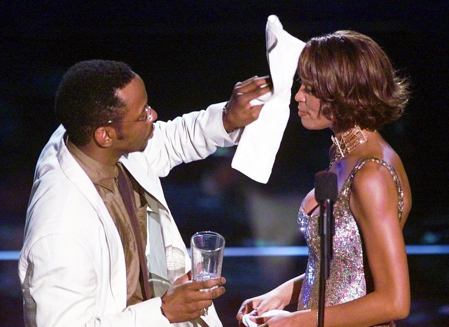 Bobby Brown Wipes Sweat From Whitney Houston During Arista Records April 2000 Concert Bobbi Kristina Brown Life With Whitney Houston and Bobby Brown