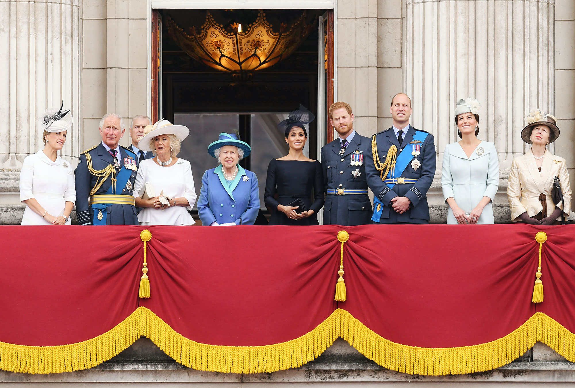 The Royal Family on the balcony of Buckingham Palace during the 100th Anniversary of the Royal Air Force Prince Harry Says Royal Family Cut Him Off Financially After Exit