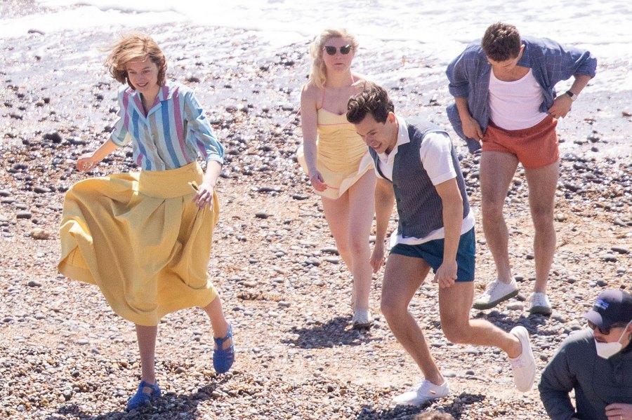 Harry Styles Emma Corrin and David Dawson Skip Down the Beach on My Policeman Set 3