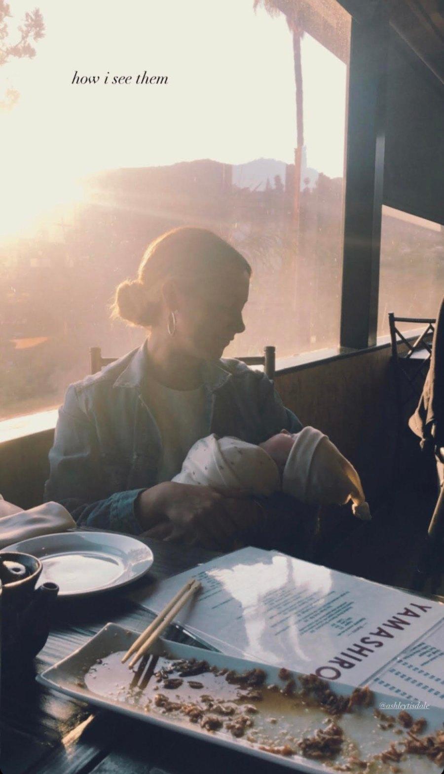 Ashley Tisdale holds Jupiter French