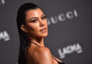 Attention Travis Kourtney Kardashian Is Promoting Sex Belts Now