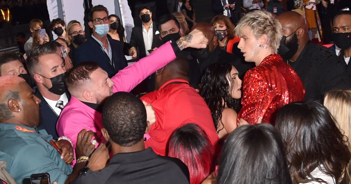 Machine Gun Kelly and Conor McGregor Appear to Fight at 2021 MTV VMAs: Pics.jpg