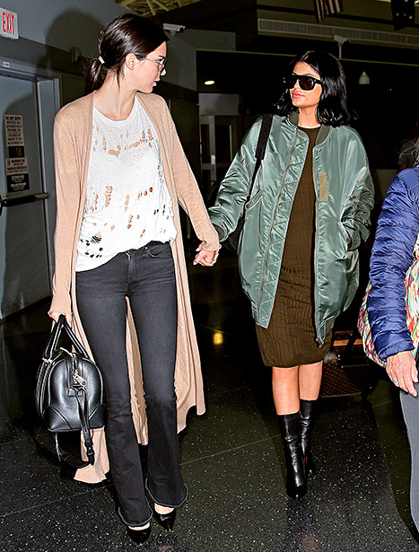 Kendall Jenner and Kylie Jenner hold hands