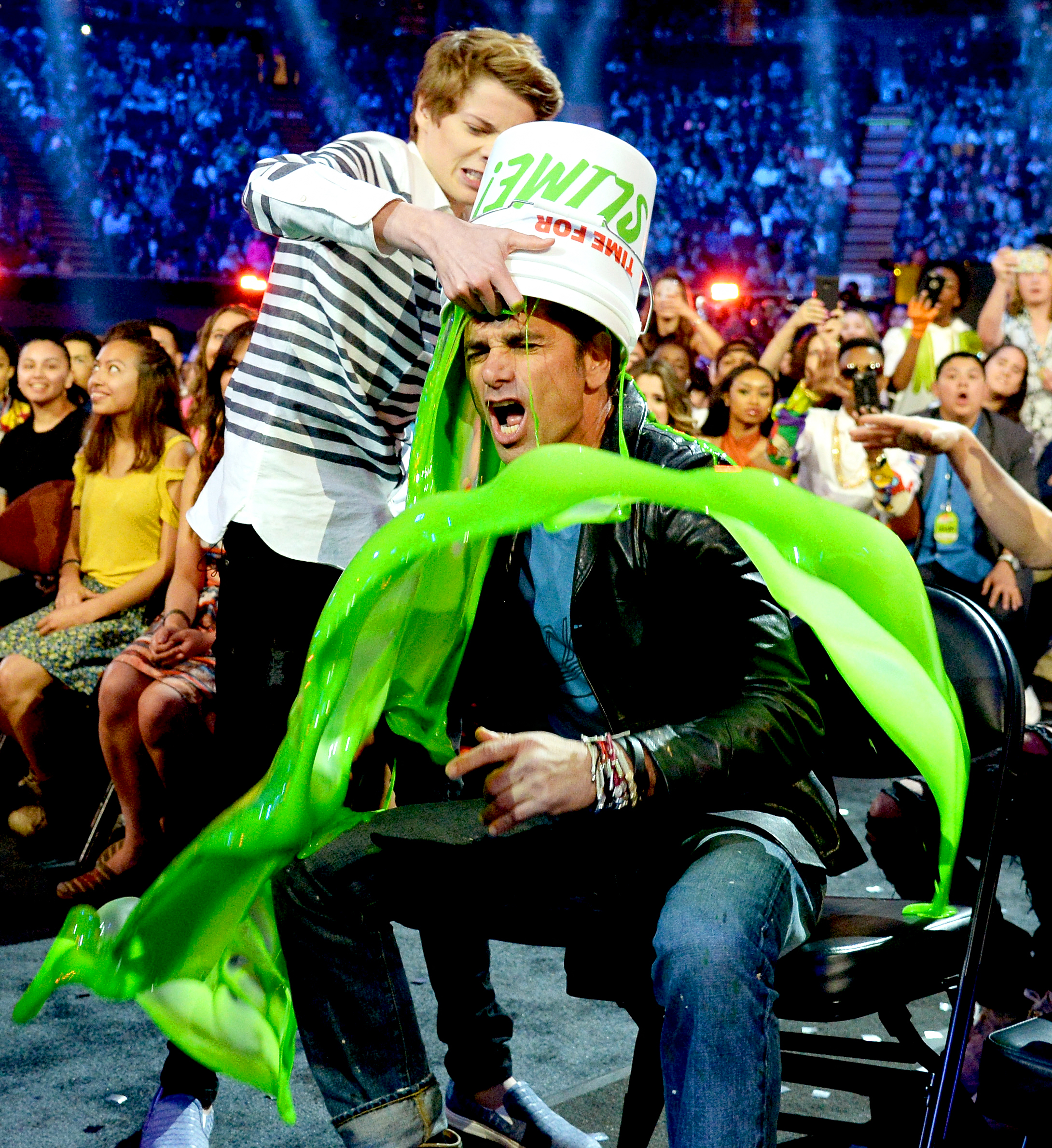 Jace Norman and John Stamos - Jace Norman came up from behind to cover John Stamos with a bucket of green goo at the awards show on March 12, 2016, but the Fuller House star got him back — by burying his slime-covered head in Norman's shirt!