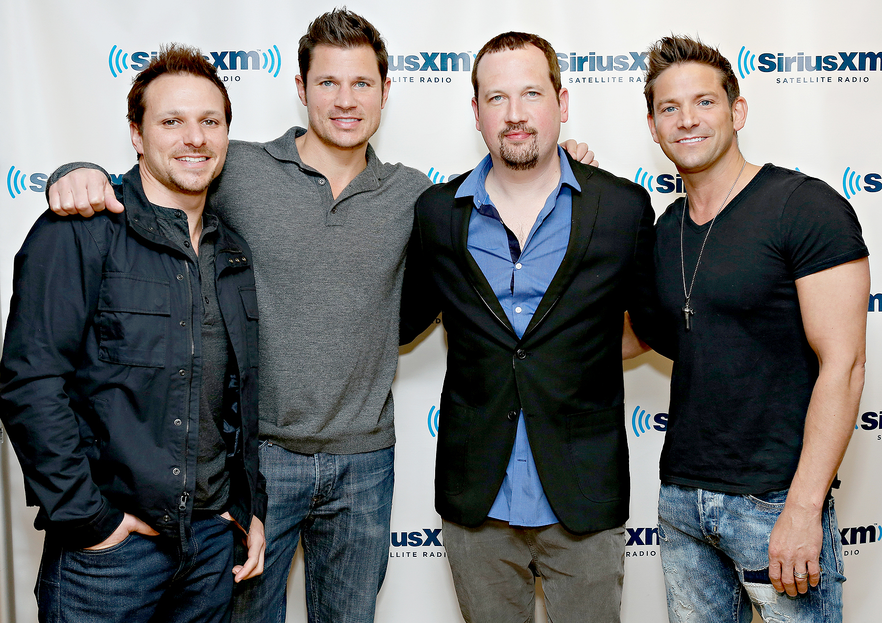 Drew Lachey, Nick Lachay, Justin Jeffre and Jeff Timmons of 98 Degrees visit the SiriusXM Studios on April 5, 2013 in New York City.